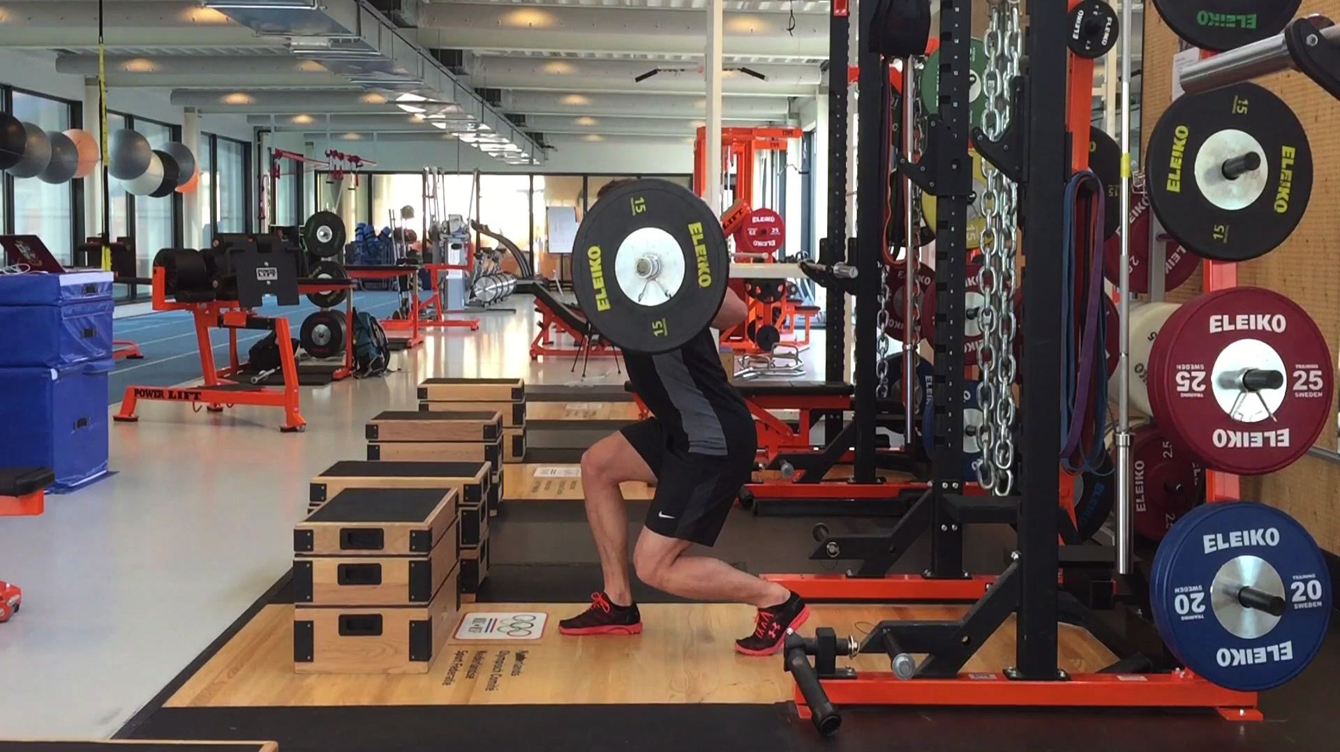 Split step squat with forward lean performed at Olympic training facility CTO Eindhoven using Eleiko Weights.